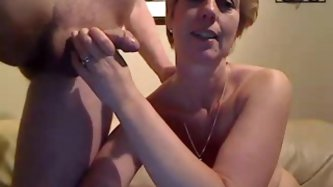 This mature babe sucks my dick and rubs it...