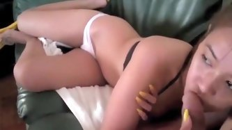 Asian girl is playing with his cock