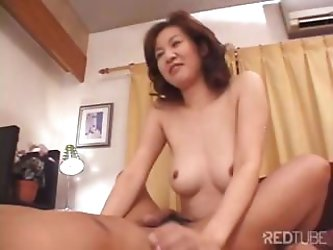 Mature Japanese housewife with a pair of...