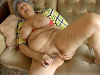 Obese granny with big saggy tits lies on...