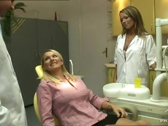 This blonde lesbian dentist is really hot,...