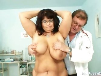 Mature Daniela has her huge tits checked...
