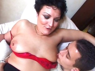 Horny big tits granny enjoying young white...