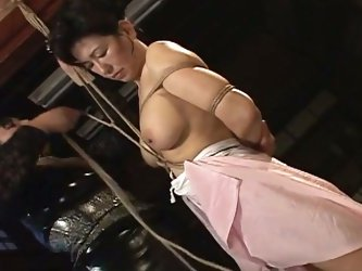 Busty asian milf bound & tied