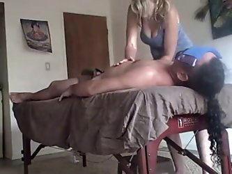 Sexy blonde masseuse looks at my dick...