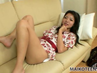 Cute teen girl Nao Miyazaki lies on the...
