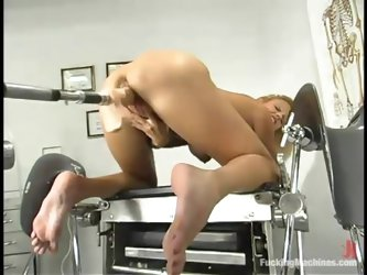 Desirable blondie is playing with a...