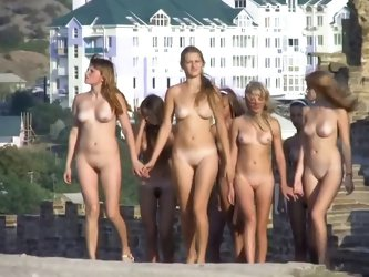 Young nudists walking 2