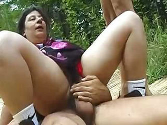 Middle-aged slut takes two hungry...
