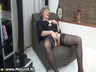 Mature housewife in sexy black stockings...
