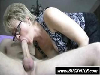 Blonde MILF with glasses sucks his hard...
